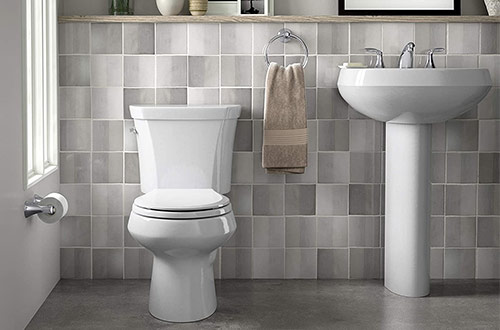 Black Kohler K-3987-7 Wellworth Two-Piece Round-Front Dual-Flush Toilet with Class Five Flush System and Left-Hand Trip Lever